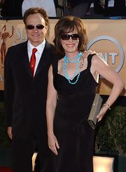 Jane Kaczmarek wore a turquoise lariat necklace with her black dress for a bit of color.
