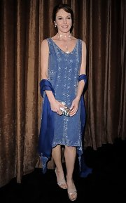 Diane Lane accented her flapper inspired look with strappy silver sandals.