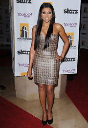 Taraji's opted for a longer center parted hair style for the Hollywood awards.