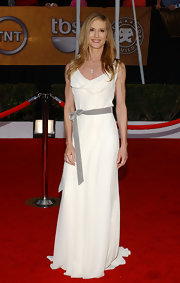 Holly looks angelic in this white floor-length evening dress.