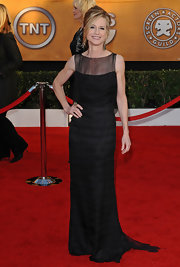 Holly looks statuesque in a long black evening dress with a lovely sheer neckline.