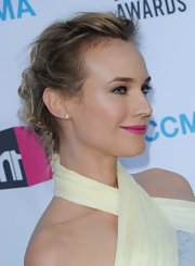 Diane Kruger wore her hair in a chic messy updo at the 17th Annual Critics Choice Movie Awards.