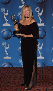 Barbra Streisand opted for simple elegance at the 2001 Emmy Awards. She wore a black velvet off-the-shoulder gown.