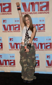 Avril Lavigne wore a horizontal striped tie over her white tank for the VMAs.