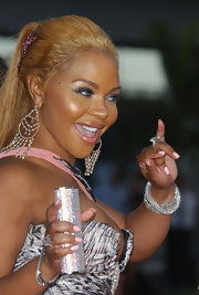 Lil Kim's diamond studded bracelet flashed as she waved to the crowd at the 2004 MTV Video Music Awards.