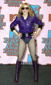 Madonna looked fierce in knee-high leather lace-up boots for the MTV Europe Music Awards.