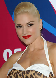 For her hairstyle, Gwen Stefani chose a sleek ponytail with a pompadour crown.