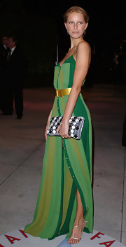 Karolina went mismatchy at the Vanity Fair Oscar Party with a green striped dress and black and white clutch.