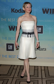 Renee Zellweger teamed her strapless white dress with black satin pumps.