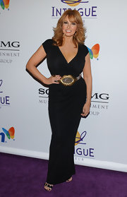 Raquel Welch emphasized her waist by wearing a large buckled belt at the Clive Davis Grammy party.