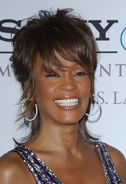 Whitney Houston looked great with her short layered cut at the 2008 pre-Grammy party.