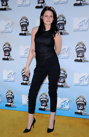 Kristen rocks stylish black capris with a shimmering top.