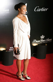 Gabrielle finished off her white draped dress with peep toe sandals.