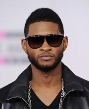 Usher paired his black leather jacket with black shades while attending the American Music Awards.