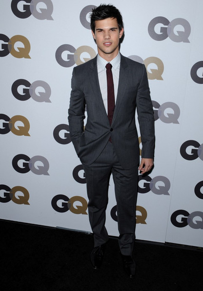 Taylor Lautner attended the 15th Annual GQ Men of the Year party wearing a heather grey, notch lapel suit, white checkered shirt and burgundy tie.