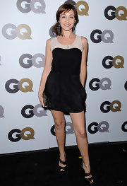 Autumn Reeser donned black satin sandals to the GQ Men of the Year party. She paired the heels with a black LBD.