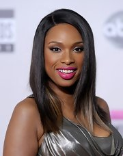 Jennifer Hudson add a bold pop of color to her look at the 2011 American Music Awards with a satin-finish fuchsia lipstick.
