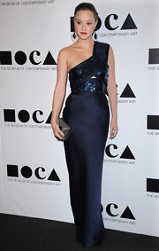 Devon Aoki wore a navy sequined evening dress with a cinched waist and elongated silhouette for the MOCA Gala.