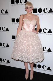 Rosson Crow was ballerina chic in a pale pink cocktail dress with a full skirt. She topped off the look with nude platform pumps.