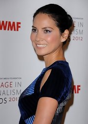 Olivia Munn's classic bun showed off her fun iridescent eye shadow.