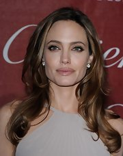 Angelina Jolie wore her long hair in loose waves at the 2012 Palm Springs International Film Festival.