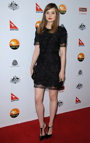 Bella Heathcote opted for T-strap suede pumps to match her LBD at the gala.