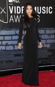 Naya showed off some skin with this long-sleeve slinky dress with cutout details.