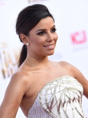 Eva Longoria looked elegant at the NCLR ALMA Awards wearing this low ponytail with a teased crown.