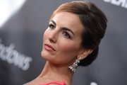 Camilla Belle wore a pair of diamond chandelier earrings by Chopard for an ultra-elegant finish.