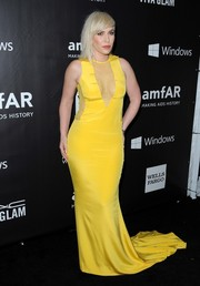 Natasha Bedingfield brightened up the amfAR Inspiration LA Gala black carpet with this cleavage-baring gown in a striking yellow hue.