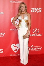 Sheryl Crow looked groovy at the MusiCares Person of the Year Gala in an Edition by Georges Chakra jumpsuit featuring a sequined bodice and a keyhole neckline.