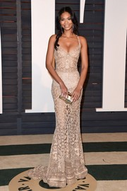Chanel Iman chose a gorgeous nude gown with sheer detail by Zuhair Murad for the Vanity Fair Oscar Party.