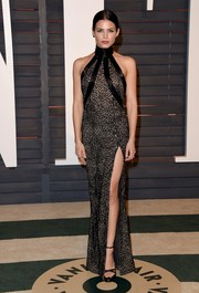Jenna Dewan-Tatum oozed sex appeal in a high-slit black and nude halter gown by Zuhair Murad at the Vanity Fair Oscar party.