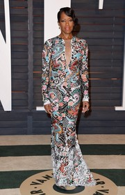 Regina King made a dynamic fashion statement in a long-sleeve eclectic-print gown during the Vanity Fair Oscar party.