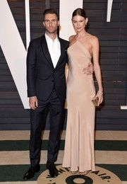 Behati Prinsloo kept it minimal yet oh-so-sexy and elegant in a nude halter gown by Calvin Klein during the Vanity Fair Oscar party.
