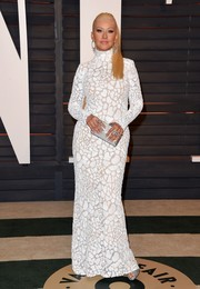 Christina Aguilera was white-hot at the Vanity Fair Oscar party in a figure-hugging Marc Bouwer mesh gown.