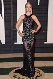 Bella Heathcote went the vampy route in a black mixed-lace evening dress by Emilio Pucci during the Vanity Fair Oscar party.