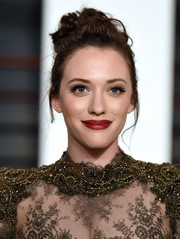Kat Dennings went for an ultra-feminine look with this lovely loose bun teamed with a lace dress at the Vanity Fair Oscar party.