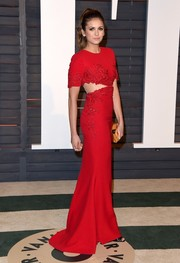 Nina Dobrev was trendy and elegant at the Vanity Fair Oscar party in a red Reem Acra gown with side cutouts and lace accents.