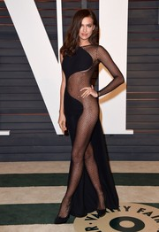 Irina Shayk donned a black Atelier Versace number that was half gown and half studded, see-through catsuit for the Vanity Fair Oscar party.
