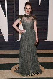 Kat Dennings kept it demure and very elegant at the Vanity Fair Oscar party in a gray Gemy Maalouf lace gown with a heavily embellished neckline and shoulders.