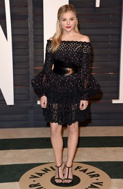 Chloe Grace Moretz went for boho charm in a floral-embroidered black off-the-shoulder dress by Alexander McQueen during the Vanity Fair Oscar party.