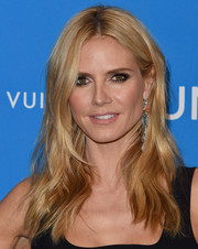 Heidi Klum sported an edgy-chic center-parted 'do with subtly wavy layers at the UNICEF Ball honoring David Beckham.