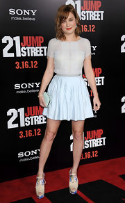 Brie Larson accessorized her look with platform cutout booties complete with printed detailing.