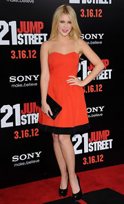 Renee Olstead wore this orange strapless dress with a black striped hem to the '21 Jump Street' premiere.