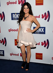 Lucy Hale balanced her frothy blush dress with black suede peep toe booties.
