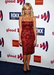 Kristin Chenoweth teamed her sparkly red cocktail dress with black satin platforms.