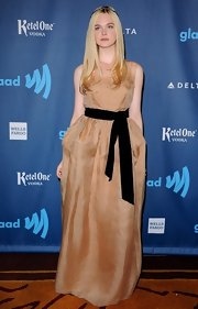 Elle Fanning chose this nude-blush dress with a black sash for her gorgeous red carpet look at the GLAAD Media Awards.