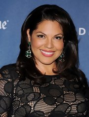 Sara Ramirez added a touch of color to her red carpet look with a fuchsia lip color.