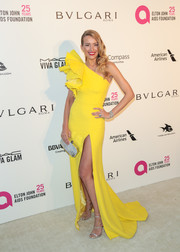 Petra Nemcova made an eye-catching entrance in a lemon-yellow Celia Kritharioti one-shoulder gown with ruffle detailing at the Elton John AIDS Foundation Oscar-viewing party.